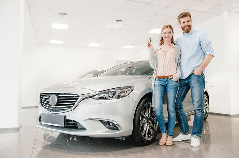 Couple who just got a great deal on a new car